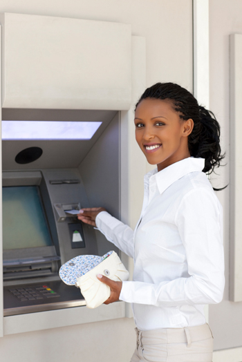 woman withdrawing money from atm machine