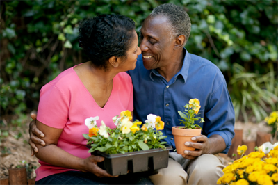 older couple in a flower garden