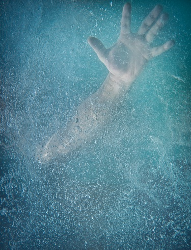 drowning... hand under water
