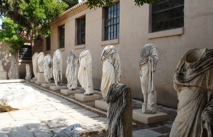 headless idols in Corinth
