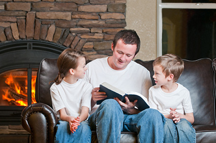 Dad and kids reading the Bible