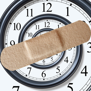 clock covered with a band-aid