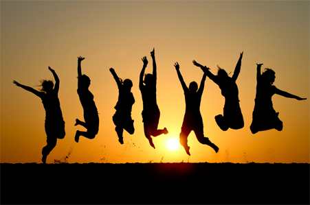 silhouette of people jumping for joy