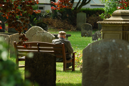 man sitting in cemetary