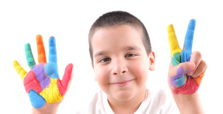 young boy holding up seven fingers
