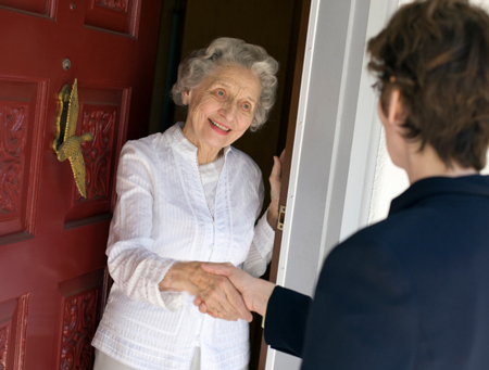 young man visiting elderly woman in the city