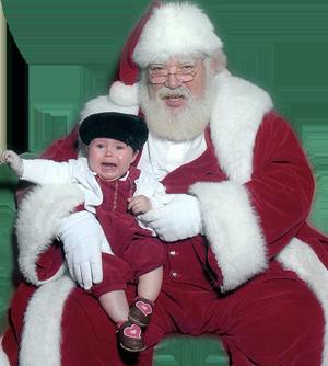 Papá Noel con el niño que llora
