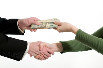 two people exchanging money (a business transaction)