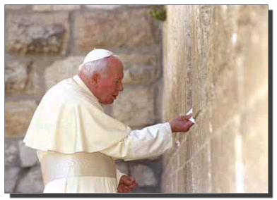 John Paul II, inserting a prayer slip into the Wailing Wall, Jerusalem