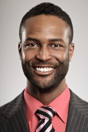smiling man wearing a suit