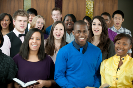 young people singing in a church