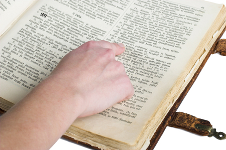 finger pointing to Bible text