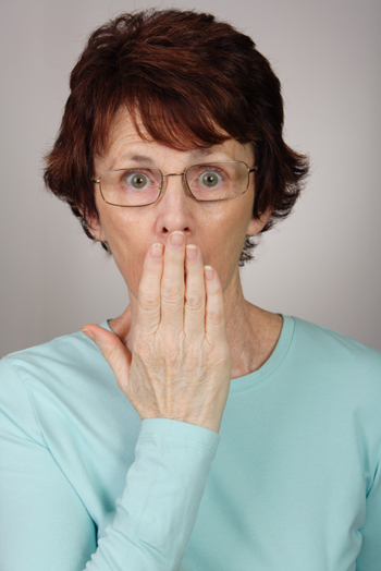 Older woman with glasses shocked by talking candidly about masturbation