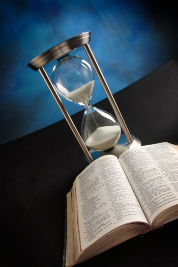 Hourglass and open Bible