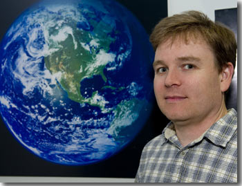 Robert Simmon in front of the Blue Marble