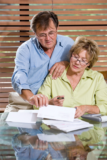 older couple looking over their bills