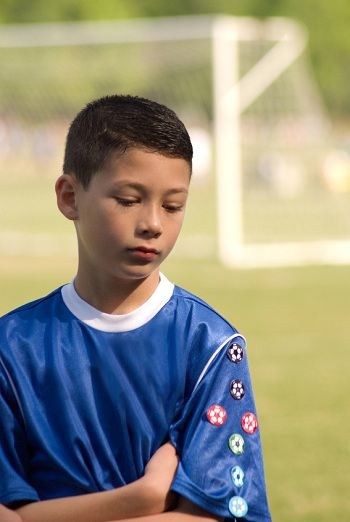 disappointed young boy at a soccer match