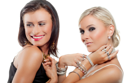 two girls wearing heavy makeup and excessive jewelry