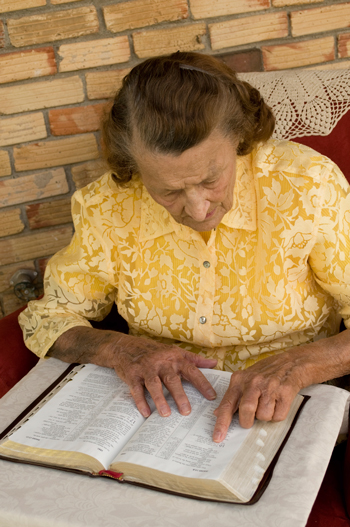 elderly lady studying the Bible