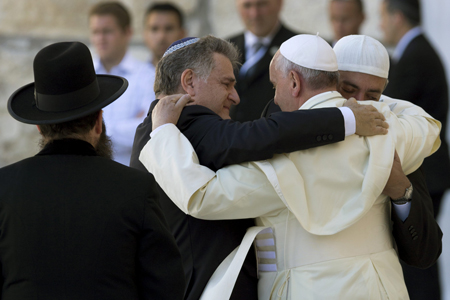 Pope Francis embracing Jews and Muslims on his May 2014 trip to Israel.