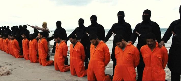 ISIS pregătindu-se să decapiteze creștini pe o plajă