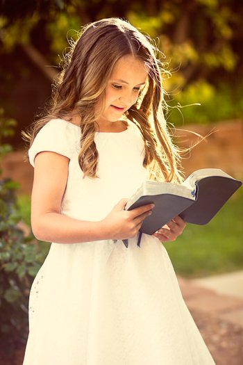 happy girl reading Bible