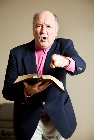 pointing man holding Bible