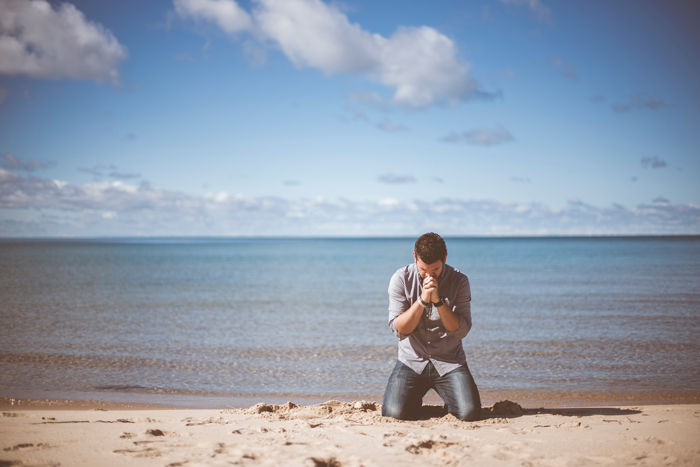 praying on the beach