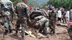 Dozens killed as landslide sweeps buses off road into gorge