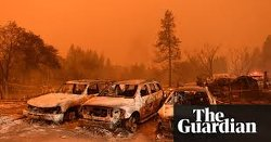 Wildfires rage in California: 'a massive wall of fire'