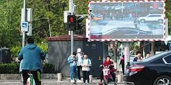 Video: Chinese Social Credit Score Publicly Shames Bad Citizen For Jaywalking